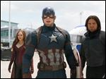 From left, Elizabeth Olsen, Chris Evans, and Sebastian Stan star in Marvel's 'Captain America: Civil War,' which opens in theaters nationwide on Friday.