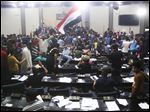 Supporters of Shiite cleric Muqtada al-Sadr storm Parliament in Baghdad's Green Zone today. Dozens of protesters climbed over the blast walls and could be seen storming the Parliament building, carrying Iraqi flags and chanting against the government.