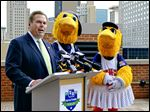 Bob LaClair of Fifth Third Bank joins mascots Muddy and Muddonna on Tuesday in announcing the 12-year extension of the naming rights agreement for Fifth Third Field.
