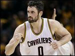 Kevin Love,  who dislocated his shoulder in last year's playoffs, has endured another scare  in Game 1.