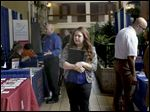Kelsey Walczak of Waterville makes her way through this year's Job & Education Fair, cosponsored by The Blade, at the Holiday Inn French Quarter in Perrysburg
