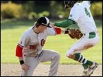 Ottawa Hills' Ben Werner steals second base against Cardinal Stritch's Jude Neary in the fifth inning. Werner hit an RBI double in the third.