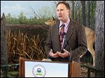 Cam Davis of the U.S. Environmental Protection Agency announces the Great Lakes Restoration Initiative grants at the Ottawa National Wildlife Refuge visitor center. He noted Lake Erie's importance as a source of drinking water and recreation for millions, saying 'that old division between the environment and economic growth is breaking down.'