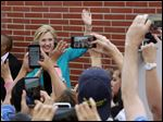Democratic presidential candidate Hillary Clinton waves to students campaigns at East Los Angeles College in Los Angeles on Thursday.