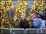 Alden Hirschfeld holds his daughter, Vivian, while his wife, Lauren, takes in the sights at the Toledo Zoo in December. Hirschfeld credits his wife and Walleye teammates with helping him recover from brain surgery.