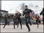 Anthony Mackie, from left,  Paul Rudd, Jeremy Renner, Chris Evans, Elizabeth Olsen and Sebastian Stan appear in a scene from