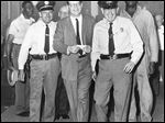 Lt. Eugene Nusbaum, left, and Deputy Leo Lehman escort Merritt W. 'Tim' Green II after he was fined and jailed for contempt of court in 1960. Mr. Green died Saturday at his home in Traverse City, Mich., at the age of 85.