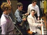 Lawrence Havelka as Elvis Presley, seated, performs with John Grieco as Jerry Lee Lewis, Jonathan Crayne as Carl Perkins and Phil Baugh as Johnny Cash in 'Million Dollar Quartet.'