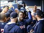 Toledo's Wynton Bernard, center, celebrates in the dugout after hitting a three-run-homer in the sixth inning of the Mud Hens' victory over Louisville on Wednesday. Bernard also had a single and a triple.