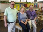 Bob Servis, left, his bother Matt Servis, right, and their sister Polly VanAcker are just a few members of the Servis family to teach in Monroe district schools.
