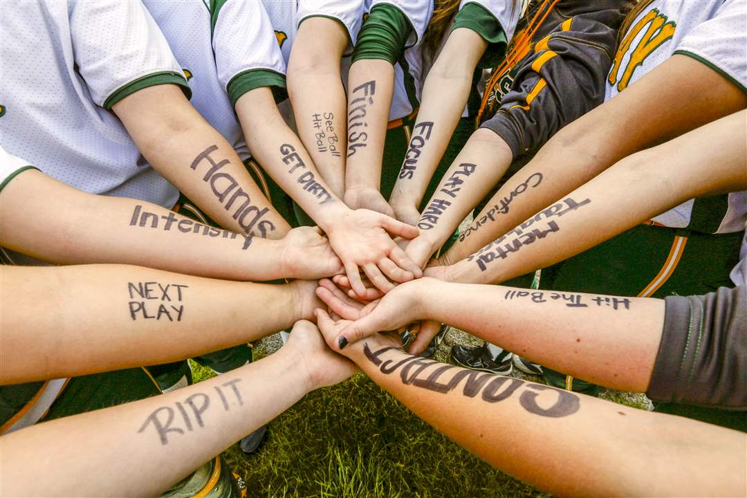 SPT-softball19pClay-players-write-messages-of-inspirati