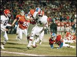 In 1988, Denver's Jeremiah Castille, on ground, looks for a loose football after stripping it from the hands of Cleveland running back Earnest Byner in the closing minutes of the AFC championship game.