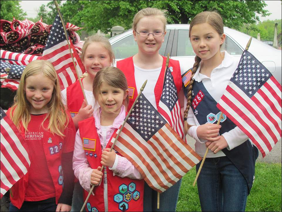 Also among the flag volunteers were American Heritage Girls, from left, Holly Dalton, 7, Bridgette Gerken, 8, Cassidy Eden, 8, Claire Gerken, 9, and Olivia Harris, 14.