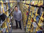 Amazon spokesman Aaron Toso stands in an aisle at the Amazon Prime Hub. The hub opened in Ohio a few weeks ago.