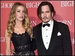 Amber Heard, left, and Johnny Depp arrive at the 27th annual Palm Springs International Film Festival Awards Gala in Palm Springs, Calif. in January.