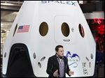 SpaceX CEO and founder Elon Musk unveils the Dragon V2 capsule in 2014.