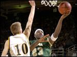 Akron St. Vincent-St. Mary's LeBron James drives to the basket past Ottawa-Glandorf's Nathan Hermiller in a 2003 Division II regional final.