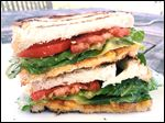 Two favorite sandwiches, the BLT and the grilled cheese, come together as one in this grilled creation.