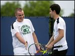 Ottawa Hills junior Tyler Gargas, left, and senior Ryan Simon celebrate their victory Saturday in the third-place doubles match at the Division II state tournament.