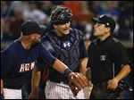 Toledo Mud Hens players Casey McGehee, left, and John Hicks argue a call with home plate umpire Jansen Visconti during the ninth inning.