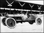 Ray Harroun drives his No. 32 Marmon Wasp race car to victory on May 30, 1911, in the inaugural Indianapolis 500.