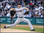 Cleveland Indians starting pitcher Josh Tomlin delivers during the first inning of Tuesday's game at Chicago. Tomlin, 7-0, helped hand White Sox pitcher Chris Sale his first loss of the year in the game.