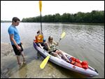 Steve Miller and Madison Moonshower of Toledo get ready to hit the Maumee River with the help of River Lures employees Drew Teifke, left,  of Tontogany, and Drew Crosser, behind the boat, of Swanton, at the Farnsworth Metropark boat launch.