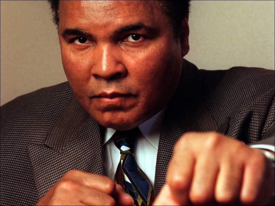 Muhammad Ali strikes a boxers pose during a 1998 interview in Pittsburgh. The former boxer was the guest of honor at a fund-raising luncheon for the Pittsburgh chapter of the National Parkinsons Foundation.