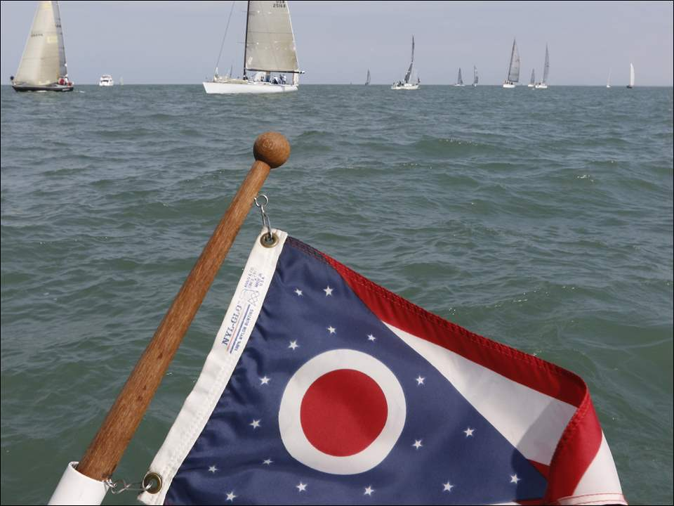 Sailboats head to the start of the Mills Trophy Race on Lake Erie, about nine miles from the Toledo Yacht Club.