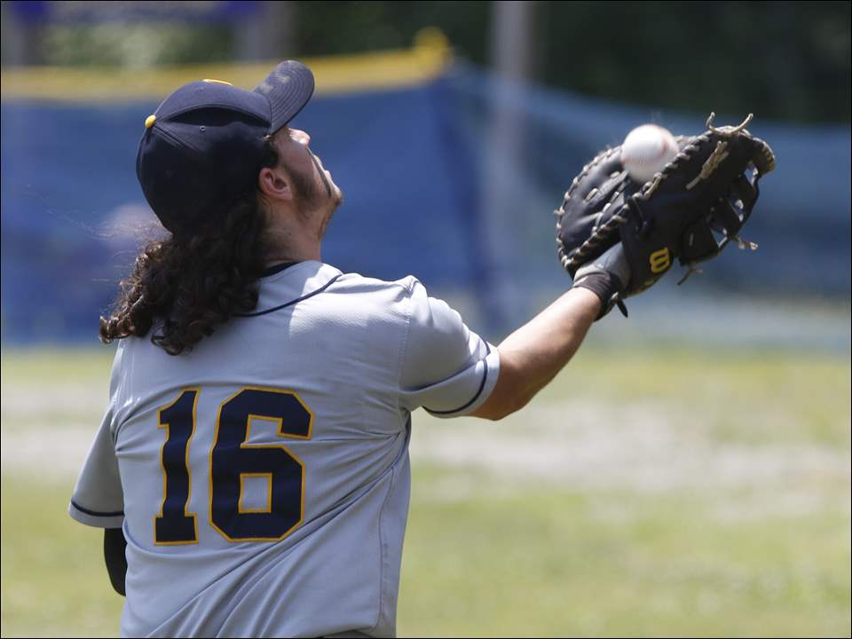 Whiteford's Hunter Nagle catches a foul ball.
