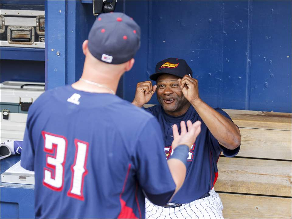 Toledo Mud Hens manager Lloyd McClendon jokes with player Casey McGehee before the Hens played Scranton/Wilkes-Barre RailRiders.