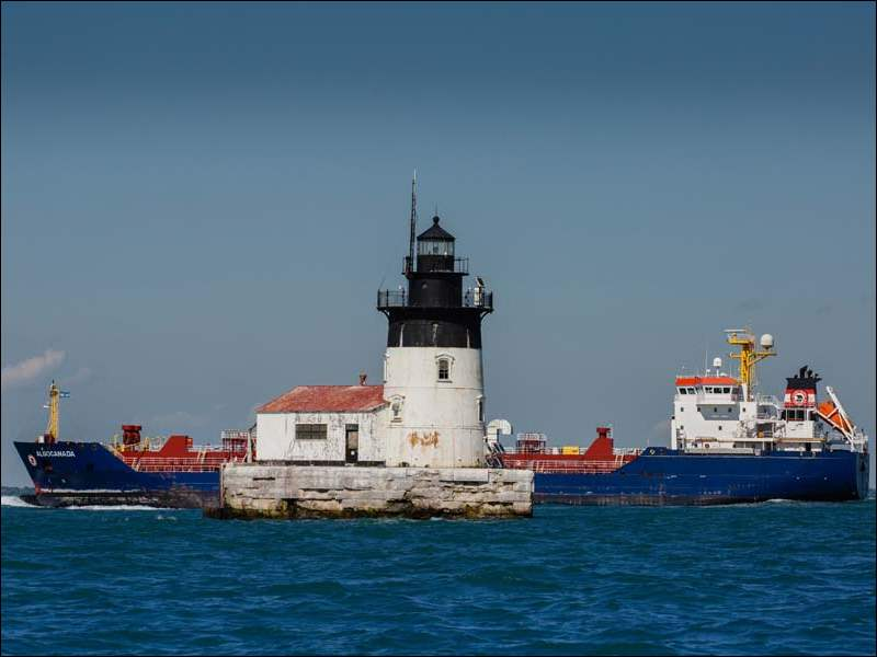 The freighter Algocanada passes the Detroit River Light as it heads from Lake Erie into the mouth of the Detroit River.