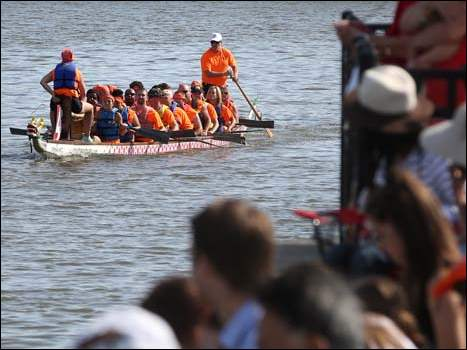 The Toledo Rotary team make their way to the starting spot for the 9:45 a.m. races during the Dragon Boat Festival.