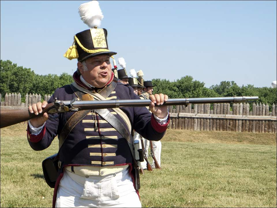 Martin Land, of Northwood, leads a group of soldiers in a musket firing demonstration. He is attired as a U.S. soldier in 1812. Land and the others are members of the Old Northwest Military History Association.