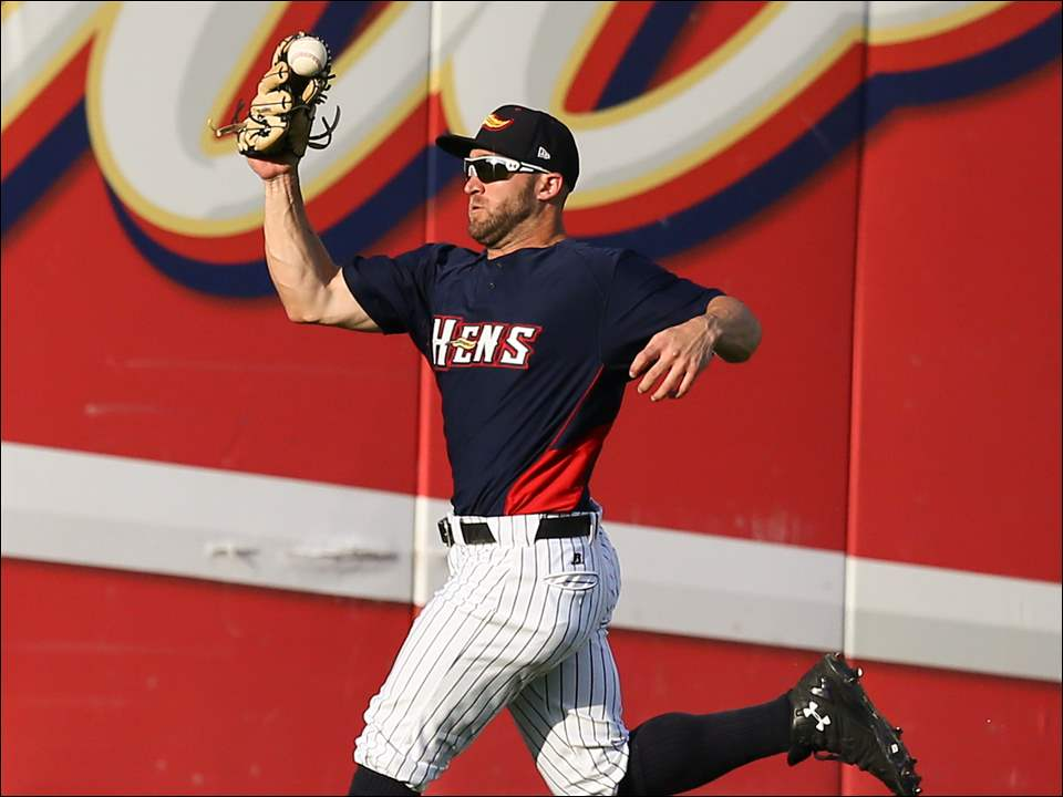 Mud Hens left fielder Tyler Collins makes a play during the third inning.