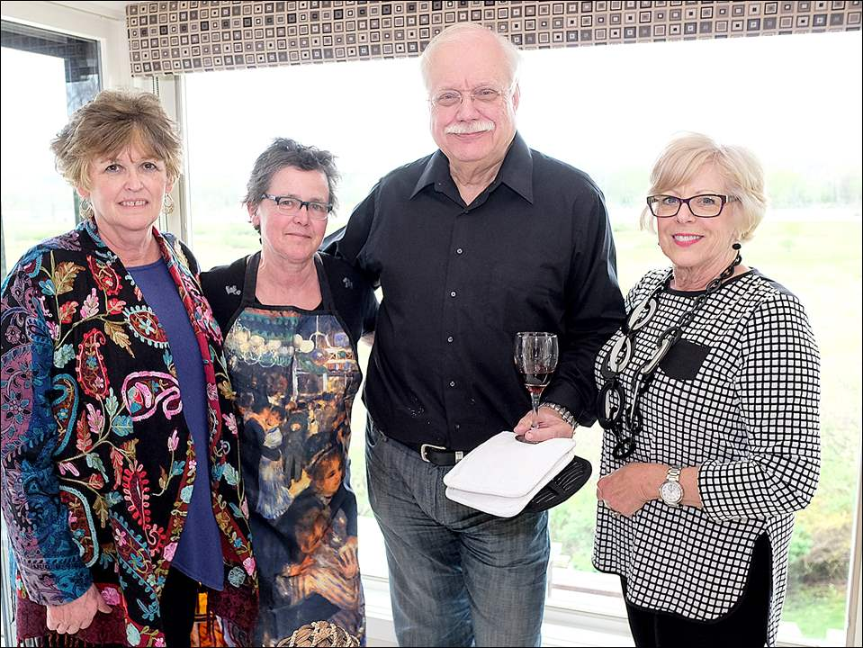 Left to right Lynda Gilbert, Christine Wilson, Marty Kokotaylo, and Marlene Uhler enjoy the Toledo Symphony League party. Mr. Kokotaylo, a chef who teaches at Williams Sonoma, led the combined cooking class and tasting event.