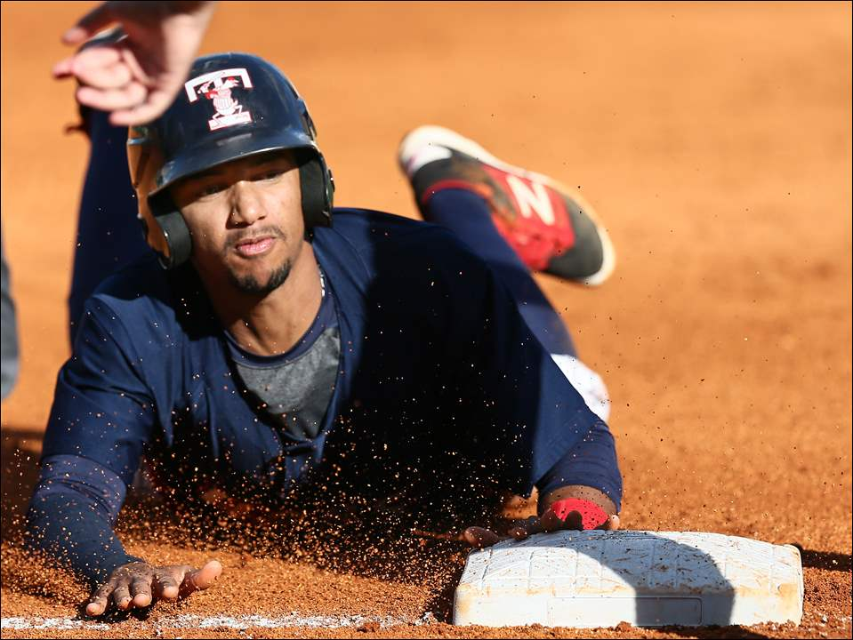 Toledo Mud Hens SS Dixon Machado steals third base against the Indianapolis Indians during the fourth inning of game one.