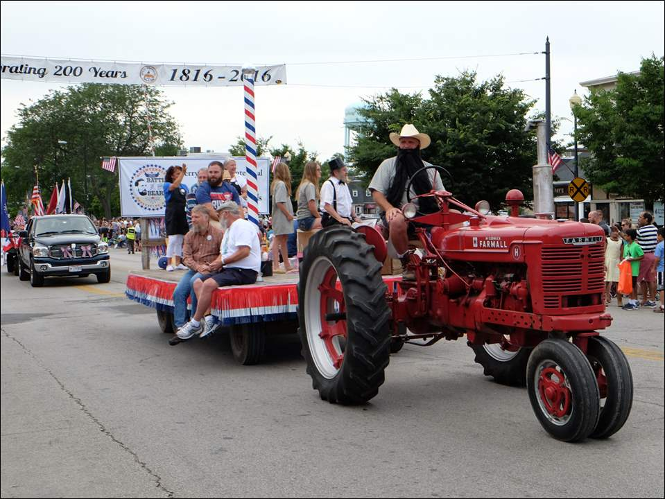 The City of Perrysburg celebrated its bicentennial with an almost 90-minute parade, complete with a flyover, bands, floats and an 11 minute interruption for a freight train.