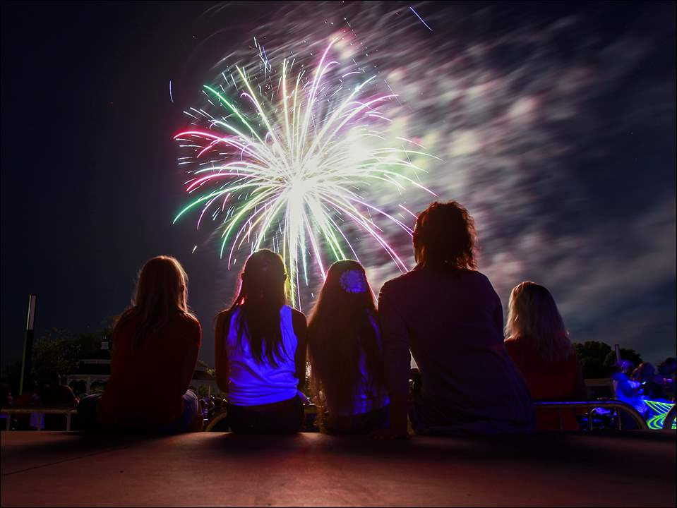 From left to right, Riley Keel, Angeline Morgillo-Zunk, Mia Morgillo, Tiffany Morgillo, and Chrissy Keel watch the Star Spangled Celebration fireworks show from the stage at Centennial Terrace in Sylvania.