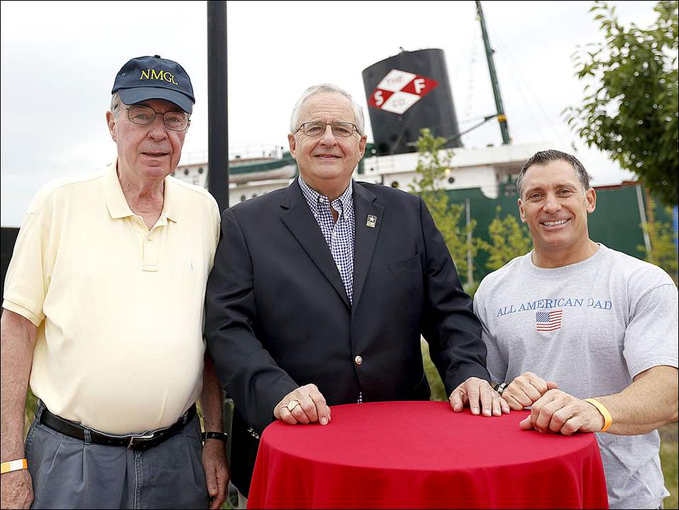 Bill Buckley, board chairman for the the National Museum of the Great Lakes, left, Joseph H. Zerbey IV, president and general manager of The Blade, center, and Col. Craig R. Baker, the commander of the 180th Fighter Wing, Ohio Air National Guard, right, at the Red White KABOOM VIP Blade party.
