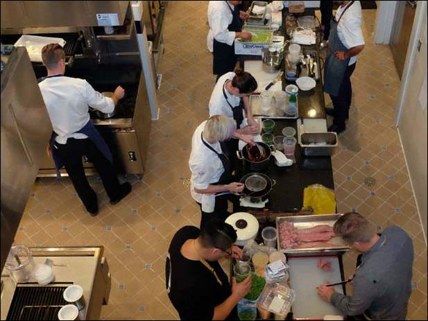 Chefs work as a team to make a fund-raising dinner at the Culinary Vegetable Institute.
