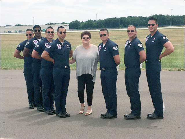 Brenda Geiger, center, with members of the Air Force Thunderbirds' ground support personnel at the Toledo Air Show.