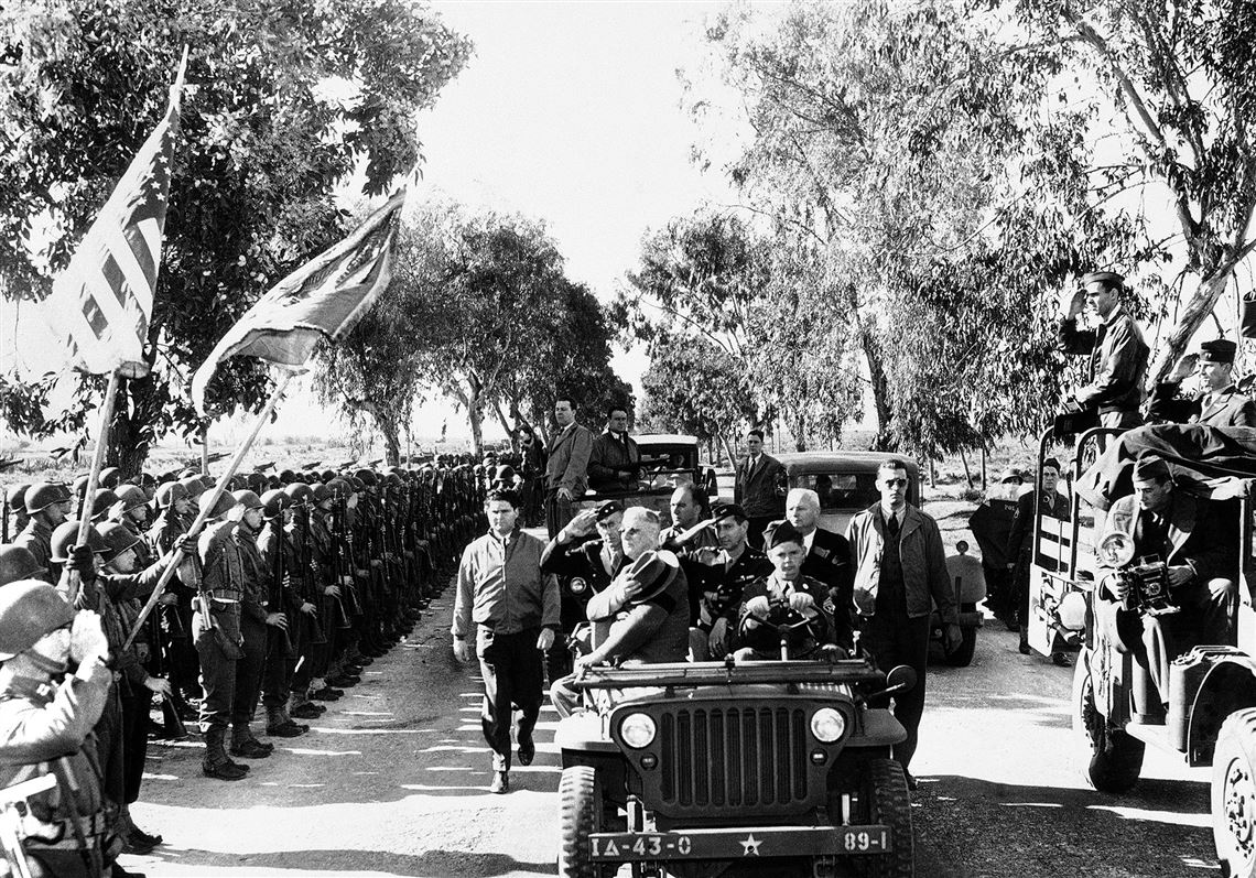 President Franklin D. Roosevelt pays his respects to the colors as he reviews U.S. troops