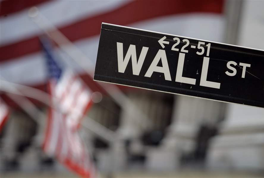 Weak oil pulls Wall Street back from record levels