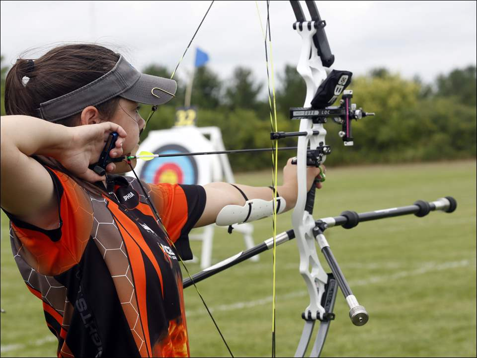 Sophie Howard, 13, of Sylvania takes aim at the target.