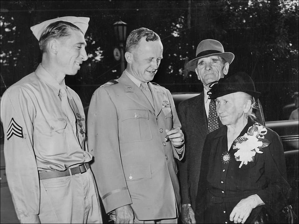 Sgt. Alex Drabik, left, Gen. Leonard and Drabiks parents at a celebration at the zoo amphitheater in Toledo on August 18, 1945. Drabik was the first Allied soldier to cross the Rhine River into Germany at the end of WWII.