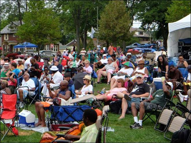 The crowd listening to the first group a performance by The Pulse Sunday at the 15th River Raisin Jazz Festival in St. Mary's Park in downtown Monroe.
