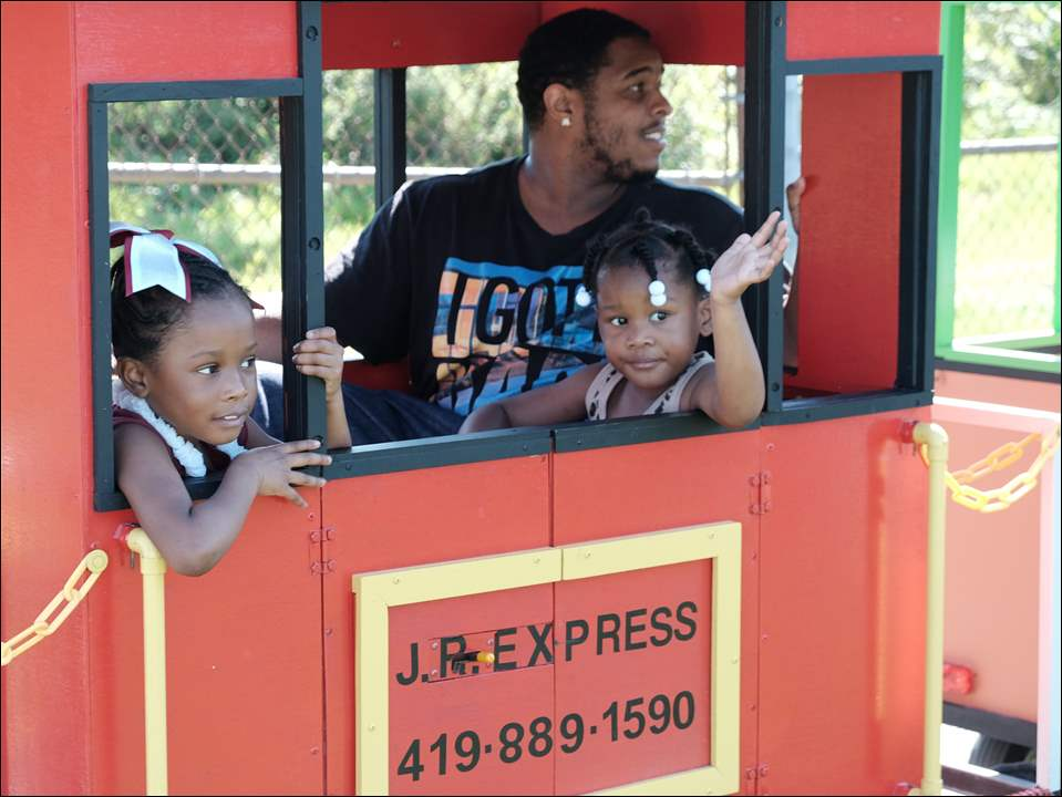 On the Freedom Express are, from left: Makhiya Craig, 6, her dad Madison Hughes, and Madison's niece, Jahnaih Atkins, 4.