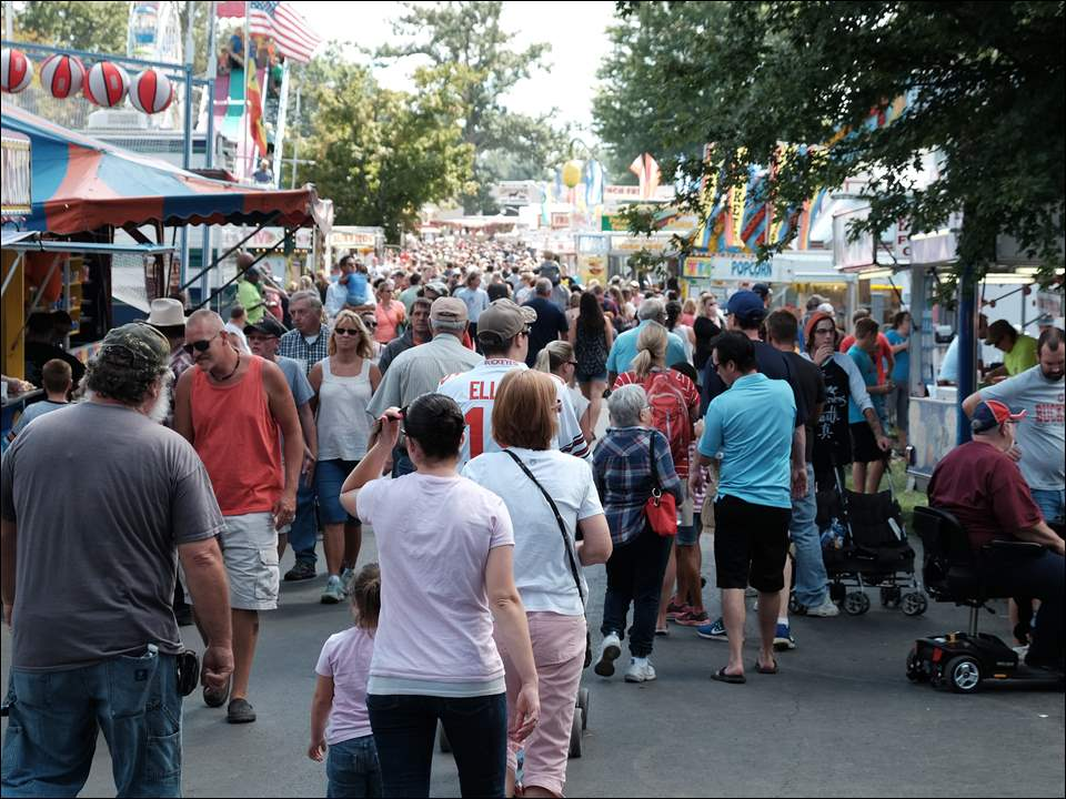 The midway at the Fulton County Fair, above, draws crowds to the fairgrounds near Wauseon for games, food, exhibits, and rides through Thursday.