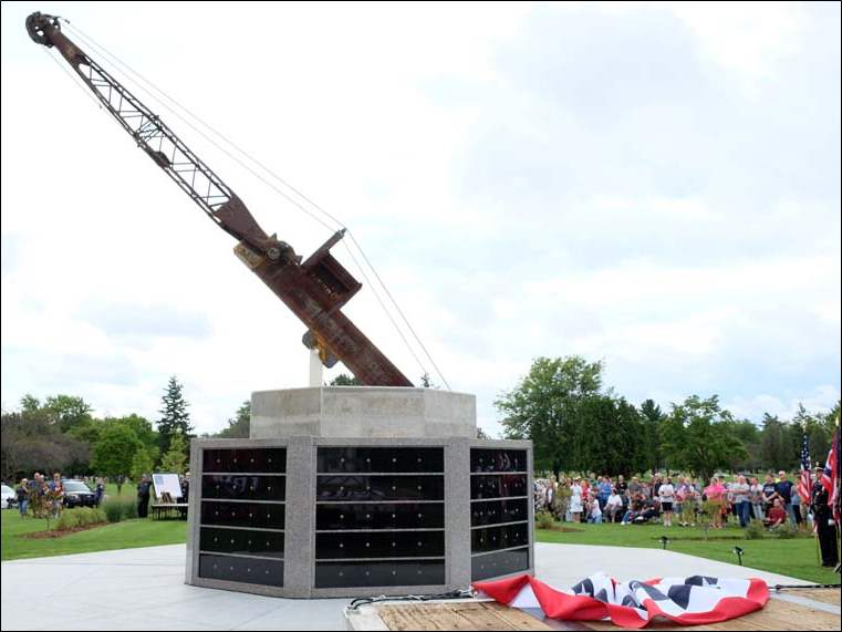 The World Trade Center beam is installed in its permanent placement atop a granite-faced foundation part of the 911 First Responders Last Call Memorial at the Toledo Memorial Park in Sylvania.